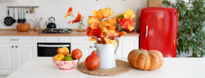 eat kitchen with autumn decorations such as fall foliage and pumpkins
