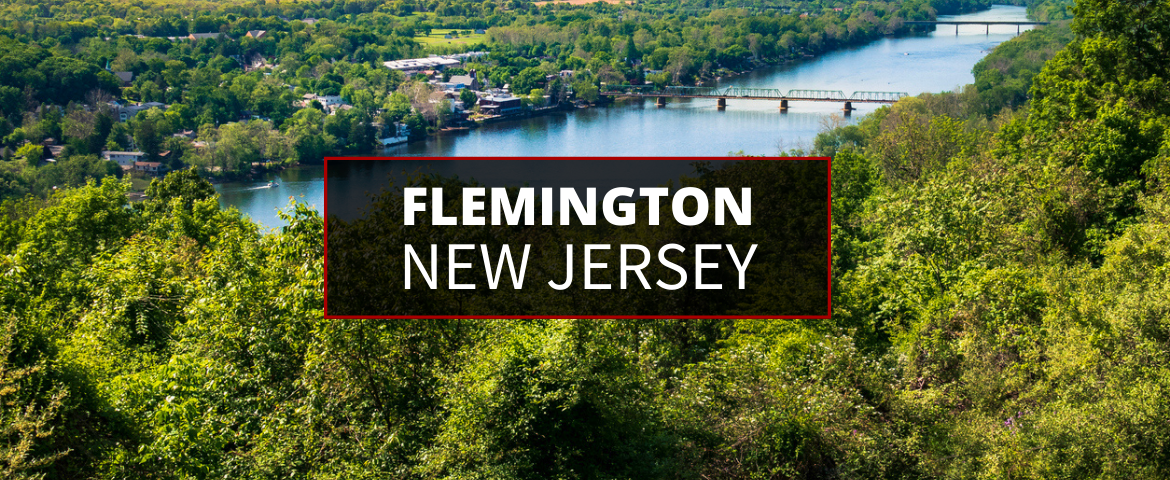 An aerial shot of a bridge crossing the Delaware River - view of Flemington located in Hunterdon County in New Jersey.